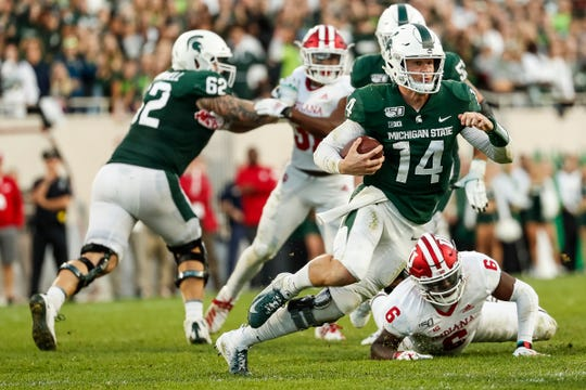 Brian Lewerke keeps the ball and runs against Indiana during the second half.