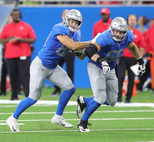 Detroit Lions tight end T.J. Hockenson (88) and guard Joe Dahl (66) run a screen pass against the Kansas City Chiefs during the first half Sunday, Sept. 29, 2019 at Ford Field.
