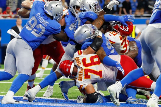 The Lions defense attempts to stop Chiefs running back Darrel Williams from scoring on a 1-yard run during the second half of the Lions' 34-30 loss on Sunday, Sept. 29, 2019, at Ford Field.