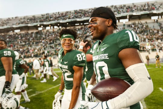 Michigan State safety Michael Dowell (10) talks to receiver Javez Alexander (82) after the Spartans' 40-31 win over Indiana at Spartan Stadium in East Lansing, Saturday, Sept. 28, 2019.