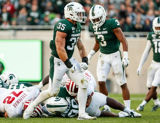 Michigan State linebacker Joe Bachie (35) celebrates a tackle against Indiana during the second half at Spartan Stadium on Sept. 28, 2019.