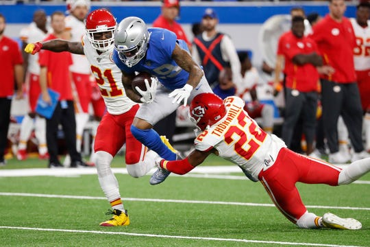 Lions wide receiver Kenny Golladay is tackled by Chiefs free safety Juan Thornhill during the first half of an NFL football game, Sunday, Sept. 29, 2019, in Detroit.