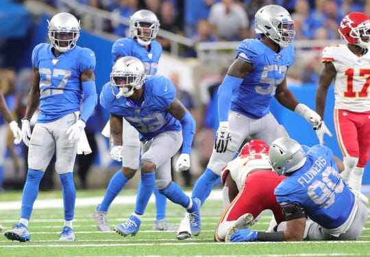 Lions safety Tavon Wilson, left, celebrates his tackle of Chiefs running back Darrel Williams during the first half Sunday.