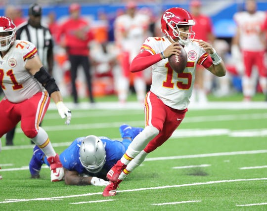 Kansas City Chiefs quarterback Patrick Mahomes escapes the tackle attempt of Detroit Lions defensive tackle A'Shawn Robinson during the second half Sunday, Sept. 29, 2019 at Ford Field.