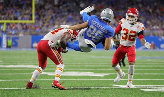 Detroit Lions tight end T.J. Hockenson is injured while making the catch against Kansas City Chiefs' Damien Wilson (54) and Tyrann Mathieu (32) during the second half Sunday, Sept. 29, 2019 at Ford Field.