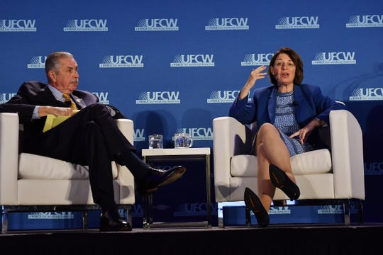 Sen. Amy Klobuchar answers a question from the audience about health care with moderator Marc Perrone, International president of UFCW.