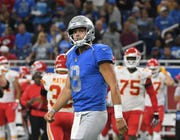 Lions quarterback Matthew Stafford walks off the field after a costly red-zone turnover in the third quarter.