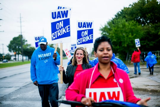 Michigan Secretary of State Jocelyn Benson, center, walks the picket line outside the General Motors Co.'s Warren Transmission Operations plant during lengthening UAW strike against the automaker.