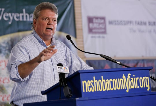 FILE - In this Aug. 1, 2019 file photo, Democrat Attorney General Jim Hood, a candidate for governor, addresses the crowd at the Neshoba County Fair in Philadelphia, Miss. While Democrats in Washington charge ahead with an impeachment inquiry, their party's candidates for governor in three Southern states, including Hood, are doing their best to steer the conversation away from Republican President Donald Trump and toward safer ground back home.