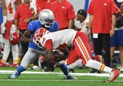 Lions' Justin Coleman forces the fumble on Chiefs' Sammy Watkins during the third quarter on Sunday.