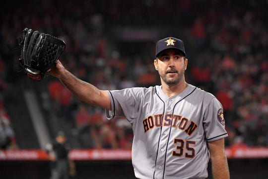 Houston Astros starting pitcher Justin Verlander waves to fans as he walks back to the dugout after striking out Los Angeles Angels' Kole Calhoun for his 3,000th career strikeout on Saturday.
