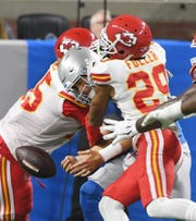 Lions quarterback Matthew Stafford fumbles the ball after getting hit by Chiefs' Chris Jones and Kendall Fuller but Detroit is able to recover in the second quarter.