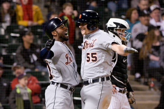 Detroit Tigers' Travis Demeritte (50) congratulates John Hicks (55) on his three-run home run in the ninth inning.