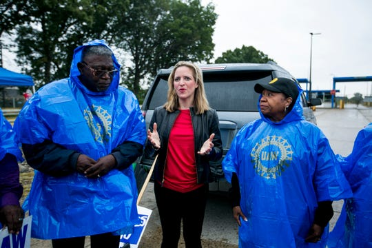 Michigan Secretary of State Jocelyn Benson speaks to demonstrators outside the GM Warren Transmission Operations plant during a UAW strike in Warren on Sunday.