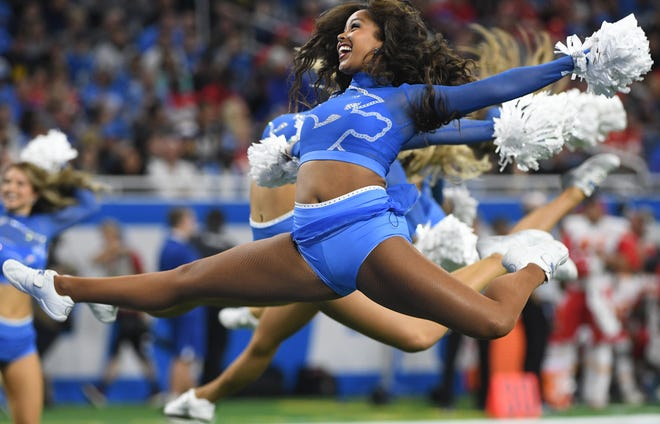 A Lions cheerleaders takes flight during a timeout performance in the first quarter Sunday,