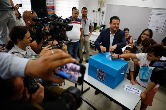 In this Sept. 17 file photo, Israeli Arab politician Ayman Odeh casts his vote in Haifa, Israel.