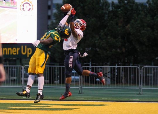 Wayne State safety Samari Dean breaks up a pass in the end zone.