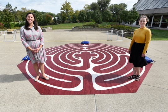Rabbi Megan Brudney, left, and Laura Williams, the director of cultural resources at Temple Beth El in Bloomfield HIlls, stand on a labyrinth set up outside the synagogue.