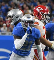 The Lions' Tracy Walker reacts after making a tackle in the first quarter.