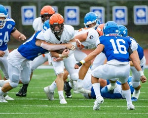 Brother Rice's Patrick O'Hara (5) tries to run the football against Catholic Central in the first half on Sunday.