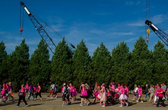Survivors and supporters begin the 1.35-mile Komen Evansville Tri-State More Than Pink Walk at Eastland Mall, Sunday morning.