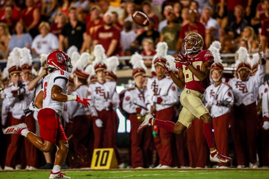 Ontaria Wilson reels in his first touchdown as a Seminoles against NC State.