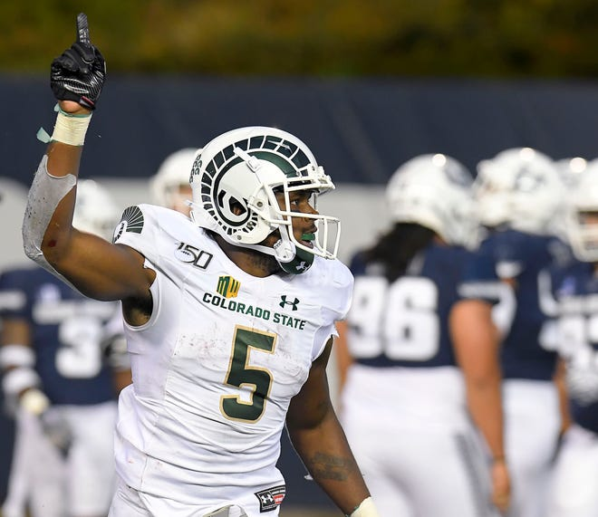 Colorado State running back Marvin Kinsey Jr. (5) celebrates after scoring a touchdown against Utah State during an NCAA college football game, Saturday, Sept. 28, 2019, in Logan, Utah.