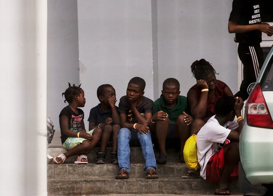 Children and adults affected by Hurricane Dorian line up at the Thomas Robinson Stadium in Nassau, Bahamas on September 21, 2019. The stadium and nearby gymnasium are acting as a shelter for those displaced by the devastating storm.