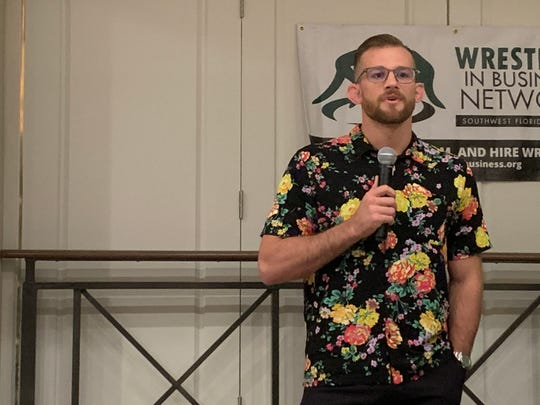 David Taylor III, a 2018 World Freestyle Wrestling Champion, speaks at the Wrestlers In Business Network fundraiser Saturday at The a Forest Country Club.