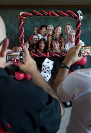 Members of the Cape Coral New Resident Club smile for photos during their Casino Night event on Saturday, September 28, 2019, at the Cape Coral Yacht Club.