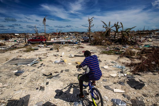 Anthony Petit Frere 12, lived in the Mudd community of Marsh Harbour, Bahamas. He was riding through the neighborhood on Tuesday, September 24, 2019. The community is a shantytown and was wiped out in the storm. Bahamian officials expect the number of fatalities from this area will rise. Anthony's family lost everything in the storm. Now he is living in another location.