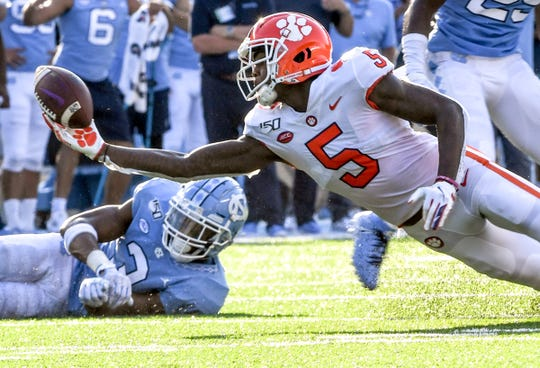 Clemson wide receiver Tee Higgins (5) nearly catches a ball near North Carolina linebacker Dominique Ross during the third quarter at Kenan Memorial Stadium in Chapel Hill, North Carolina Saturday, September 28, 2019.