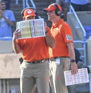 Clemson Head Coach Dabo Swinney communicates near quarterbacks coach Brandon Streeter during the second quarter  at Kenan Memorial Stadium in Chapel Hill, North Carolina Saturday, September 28, 2019.