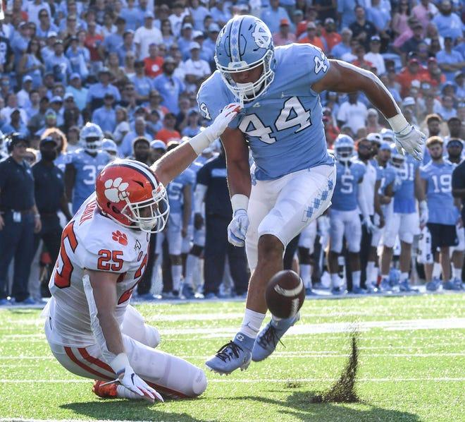 Clemson tight end J.C. Chalk (25) misses catching a pass near North Carolina linebacker Jeremiah Gemmel  during the third quarter at Kenan Memorial Stadium in Chapel Hill, North Carolina Saturday, September 28, 2019.