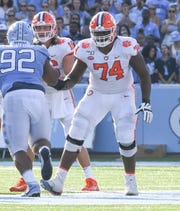 Clemson offensive guard John Simpson (74) blocks for quarterback Trevor Lawrence (16) against North Carolina during the third quarter at Kenan Memorial Stadium in Chapel Hill, North Carolina Saturday, September 28, 2019.
