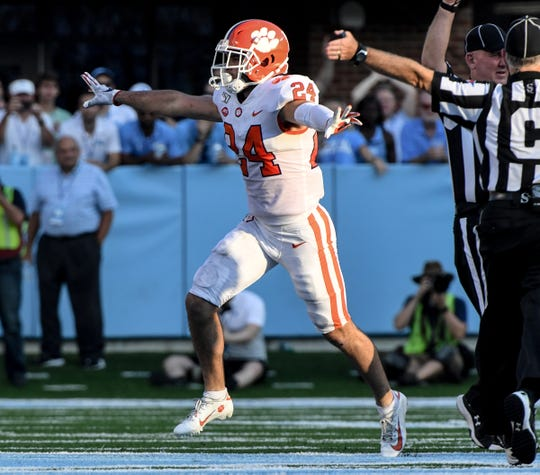 Clemson safety Nolan Turner (24) celebrates stopping North Carolina on a fourth-down attempt during the second quarter  at Kenan Memorial Stadium in Chapel Hill, North Carolina Saturday, September 28, 2019.
