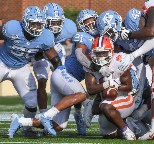 Clemson running back Travis Etienne (9) loses the ball against North Carolina during the third quarter at Kenan Memorial Stadium in Chapel Hill, North Carolina Saturday, September 28, 2019.