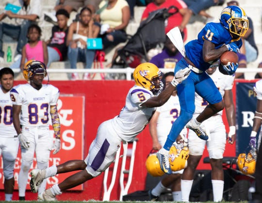 Benedict's Joshua Heyward (5) grabs Fort Valley State's Q.A. Walker (11) as he catches a pass during the HBCU Classic football game at Sirrine Stadium Saturday, Sept. 28, 2019.
