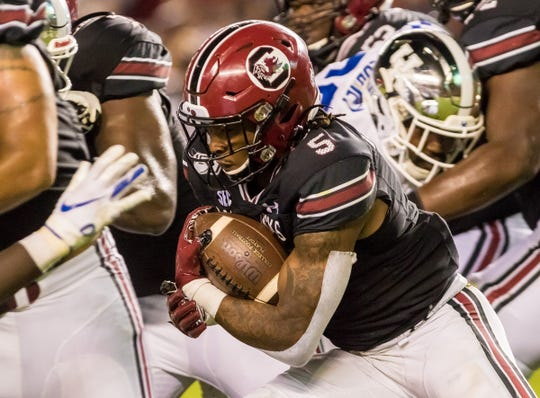 South Carolina running back Rico Dowdle (5) rushes against the Kentucky Wildcats at Williams-Brice Stadium Saturday night in Columbia.