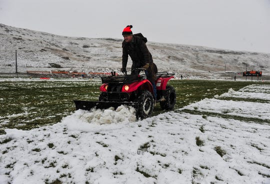 Cory Smith plows the Centerville football field ahead of Saturday's game against Belt.