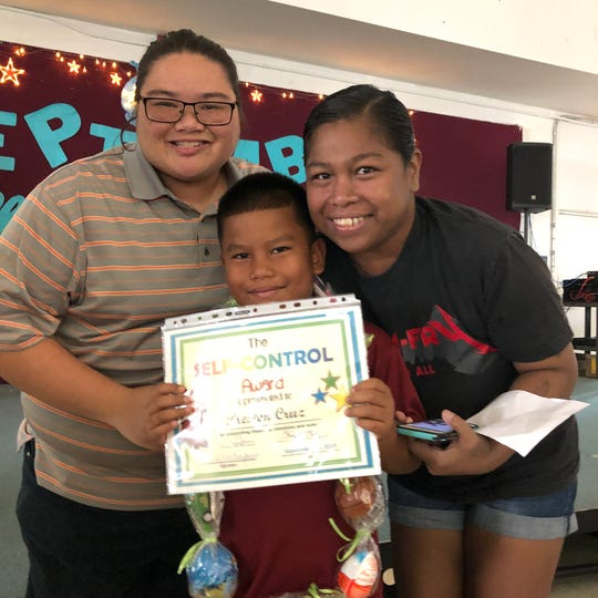 Second-grader Preston Cruz was awarded the Character of the Month from Michelle Luzano's class at Tamuning Elementary School. Each month, an award is given to the student from each classroom who has shown the most effort in demonstrating the character trait of the month. September's character trait was self-control. Cruz is pictured with moms Vanessa Camacho (left) and Juanete Cruz (right).