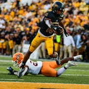 Southern Miss Golden Eagles wide receiver De'Michael Harris goes to score a touchdown against the UTEP Miners in the first half Sept. 28, 2019.