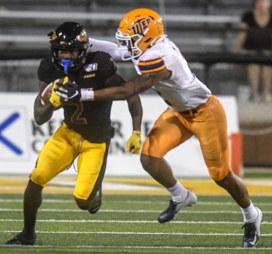Southern Miss Golden Eagles wide receiver Jaylond Adams is tackled by UTEP Miners defense Sept. 28, 2019.