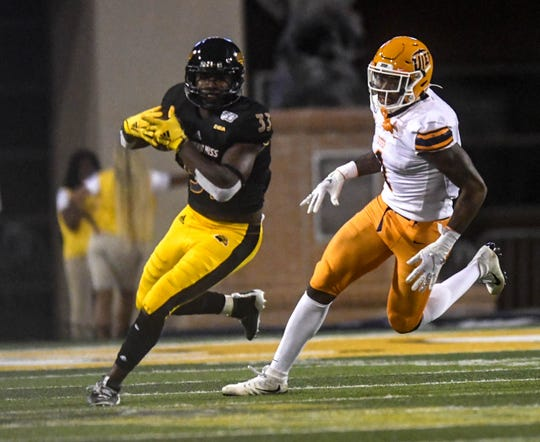 Southern Miss Golden Eagles runningback Kevin Perkins runs the ball against the UTEP Miners Sept. 28, 2019.