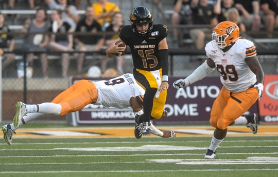Southern Miss quarterback Jack Abraham dodges a tackle by UTEP Miners linebacker Jayson Van Hook during the first half Sept. 28, 2019.