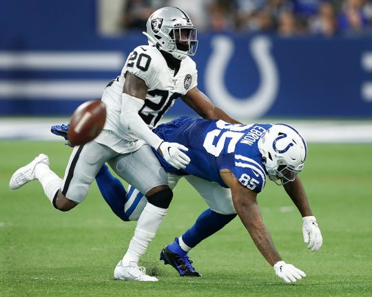 Indianapolis Colts tight end Eric Ebron (85) drops a pass as Oakland Raiders cornerback Daryl Worley (20) defends in the second half of their game at Lucas Oil Stadium on Sunday, Sept. 29, 2019. The Colts lost to the Raiders 31-24.