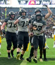 Boilermakers running back King Doerue (22) celebrates a second half touchdown along with teammates  lineman Eric Miller (74) and tight end Payne Durham (87) and lineman Grant Hermanns (78) in the second half against the  Minnesota Gophers at Ross-Ade Stadium.