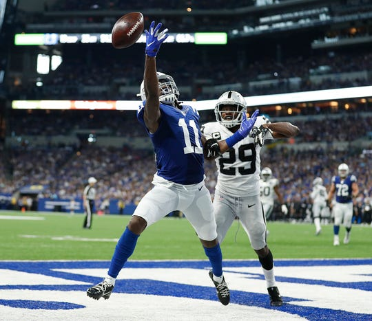 Indianapolis Colts wide receiver Deon Cain (11) reaches for the ball as Oakland Raiders free safety Lamarcus Joyner (29) defends in the second half of their game at Lucas Oil Stadium on Sunday, Sept. 29, 2019. The Colts lost to the Raiders 31-24.