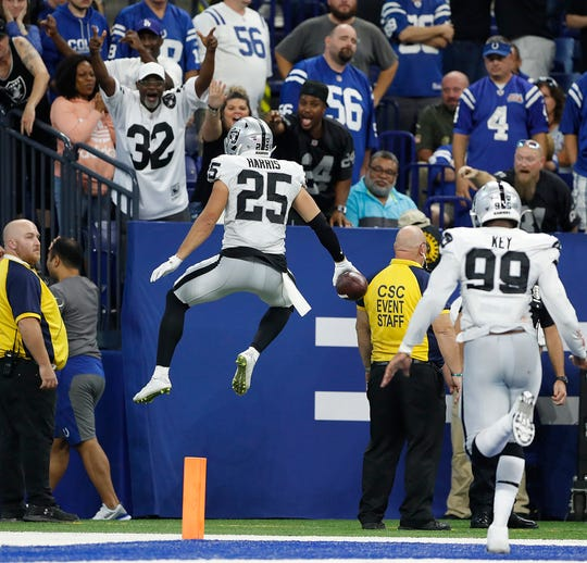Oakland Raiders free safety Erik Harris (25) celebrates his pick-six in the in the fourth quarter of their game at Lucas Oil Stadium on Sunday, Sept. 29, 2019. The Colts lost to the Raiders 31-24.
