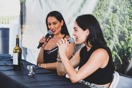 The Bella twins, Nikki Bella and her sister Brie Bella host a wine tasting during the IndyStar Wine & Food Experience, held at Clay Terrace outdoor mall in Carmel Ind., on Saturday, Sept. 28, 2019.